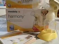 Молокоотсос ручной Medela двухфазный+бутылочки для